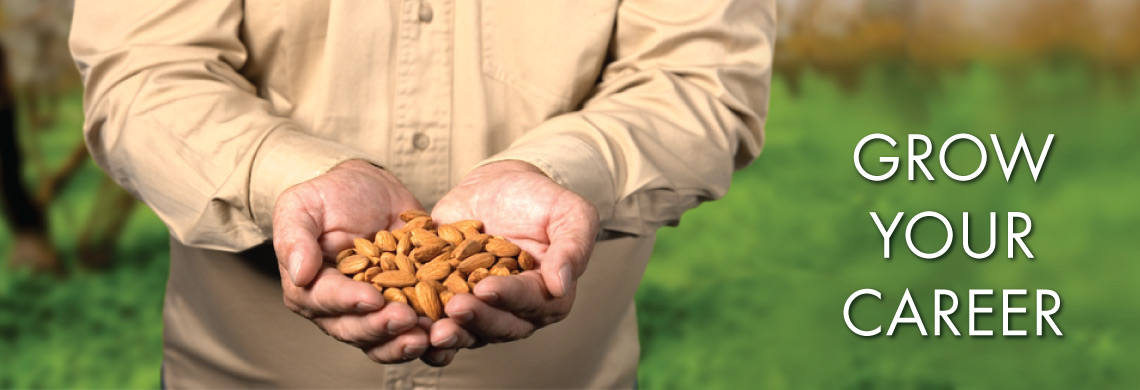 Grower holding almonds